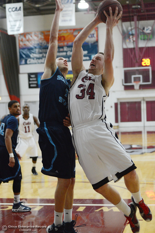 . Chico State\'s #34 Drew Kitchens (right) goes up for a shot against Sonoma State\'s #3 Jason Walter (left) in the first half of their men\'s basketball game at CSUC Acker Gym Friday January 31, 2014 in Chico, Calif. (Jason Halley/Chico Enterprise-Record)