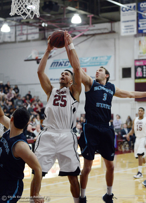 . Chico State\'s #25 Chris Magalotti (left) rebounds against Sonoma State\'s #3 Jason Walter (right) in the first half of their men\'s basketball game at CSUC Acker Gym Friday January 31, 2014 in Chico, Calif. (Jason Halley/Chico Enterprise-Record)