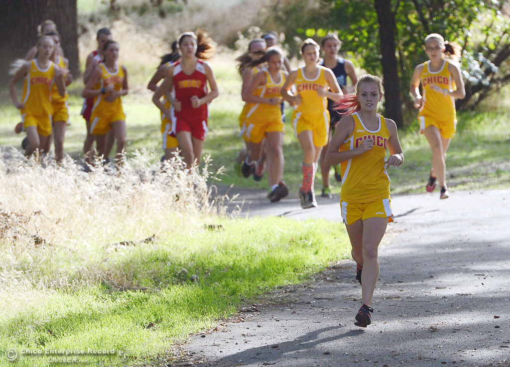 . Chico High\'s Celeste Wilson (front) sets the pace against Pleasant Valley High varsity girls cross country race at Hooker Oak Wednesday, October 2, 2013, in Chico, Calif.  (Jason Halley/Chico Enterprise-Record)