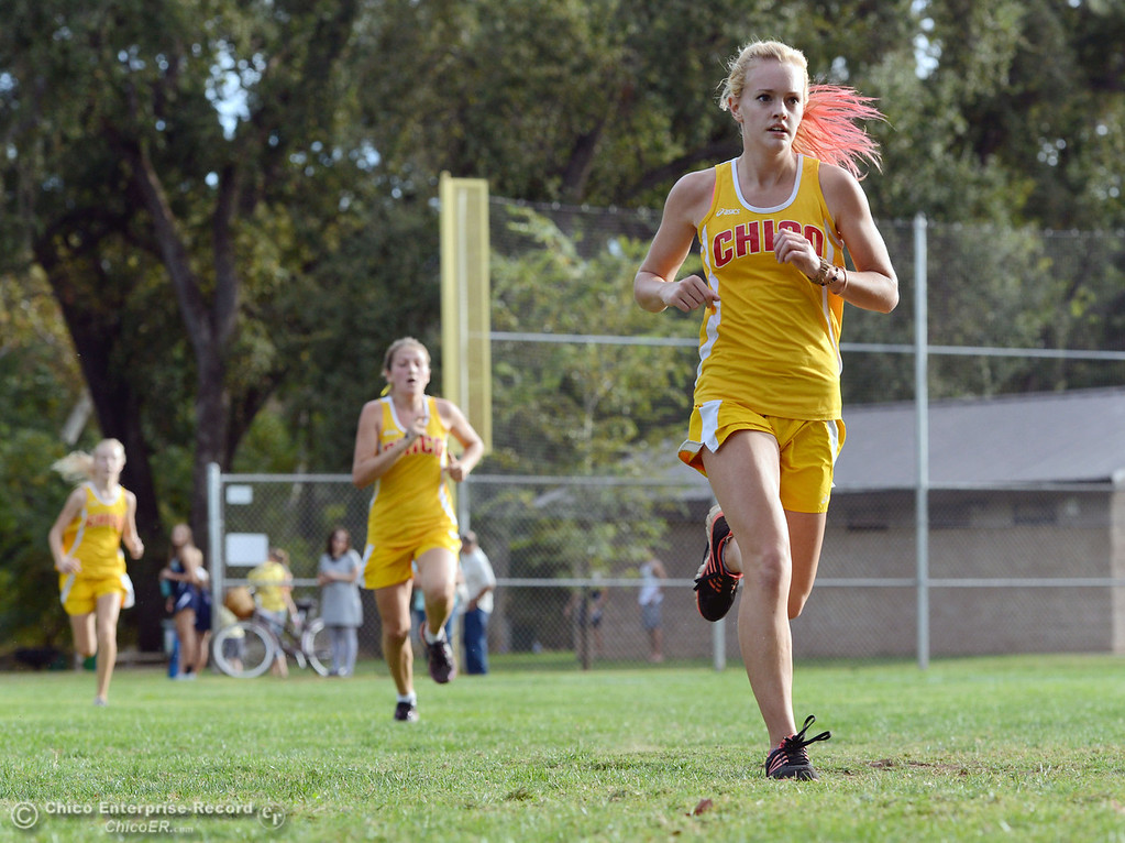 . Chico High\'s Celeste Wilson (right), Georgina Quinn (center), and Jessalyn Ayars (left) finish against Pleasant Valley High varsity girls cross country race at Hooker Oak Wednesday, October 2, 2013, in Chico, Calif.  (Jason Halley/Chico Enterprise-Record)