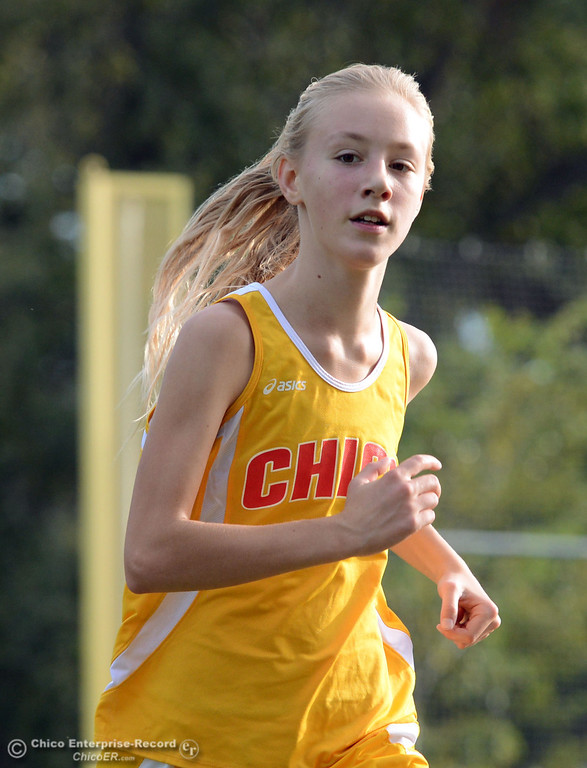 . Chico High\'s Jessalyn Ayars finishes fifth against Pleasant Valley High varsity girls cross country race at Hooker Oak Wednesday, October 2, 2013, in Chico, Calif.  (Jason Halley/Chico Enterprise-Record)
