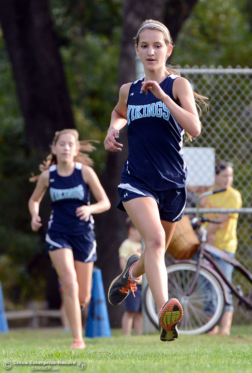 . Pleasant Valley High\'s Nicole Dully (right) ahead of Bryn Lawrence (left) finishes against Chico High varsity girls cross country race at Hooker Oak Wednesday, October 2, 2013, in Chico, Calif.  (Jason Halley/Chico Enterprise-Record)