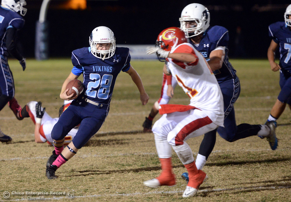 . Pleasant Valley High\'s #28 Dylan Batie (left) rushes for a touchdown against Chico High\'s #21 Cameron Alfaro (right) in the first quarter of their Almond Bowl football game at CSUC University Stadium Friday, November 1, 2013 in Chico, Calif.  (Jason Halley/Chico Enterprise-Record)