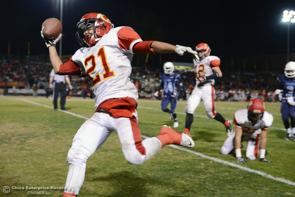 . Chico High\'s #21 Cameron Alfaro reaches for the end zone for a touchdown against Pleasant Valley High in the third quarter of their Almond Bowl football game at CSUC University Stadium Friday, November 1, 2013 in Chico, Calif.  (Jason Halley/Chico Enterprise-Record)