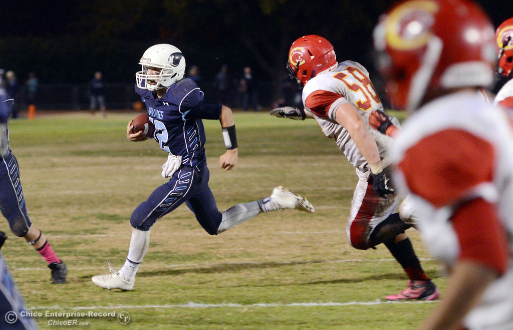 . Pleasant Valley High\'s #12 Trent Darms scrambles against Chico High in the third quarter of their Almond Bowl football game at CSUC University Stadium Friday, November 1, 2013 in Chico, Calif.  (Jason Halley/Chico Enterprise-Record)