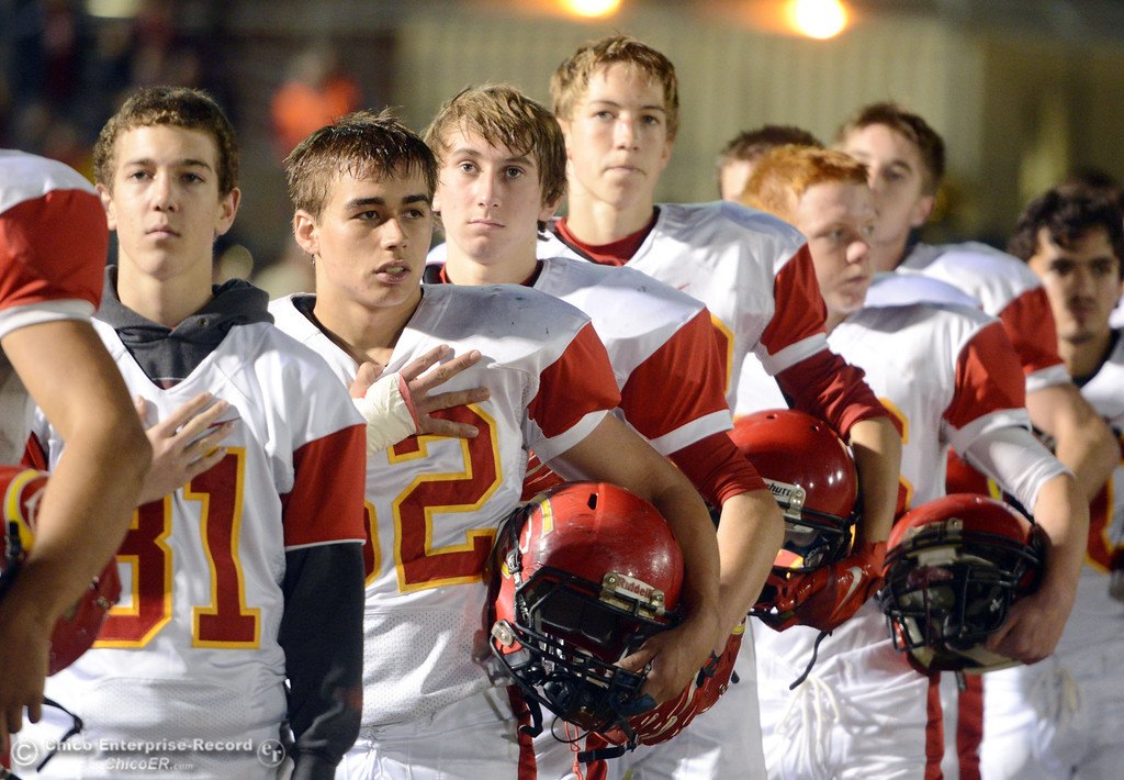 . Chico High stands during the National Anthem as they play against Pleasant Valley High in the first quarter of their Almond Bowl football game at CSUC University Stadium Friday, November 1, 2013 in Chico, Calif.  (Jason Halley/Chico Enterprise-Record)
