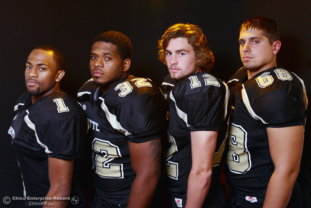 . Butte College Wes McCoy, Brian Anderson, Thomas Stuart and Eli Thom (left to right), who are leading the football team to a winning season, pose for a photo shoot at the Enterprise-Record Wednesday, November 27, 2013 in Chico, Calif.  (Jason Halley/Chico Enterprise-Record)