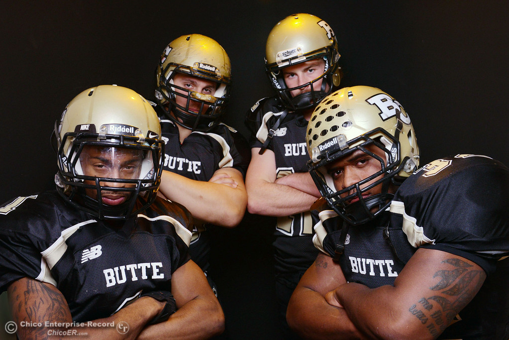 . Butte College Wes McCoy, Eli Thom, Thomas Stuart and Brian Anderson (left to right), who are leading the football team to a winning season, pose for a photo shoot at the Enterprise-Record Wednesday, November 27, 2013 in Chico, Calif.  (Jason Halley/Chico Enterprise-Record)