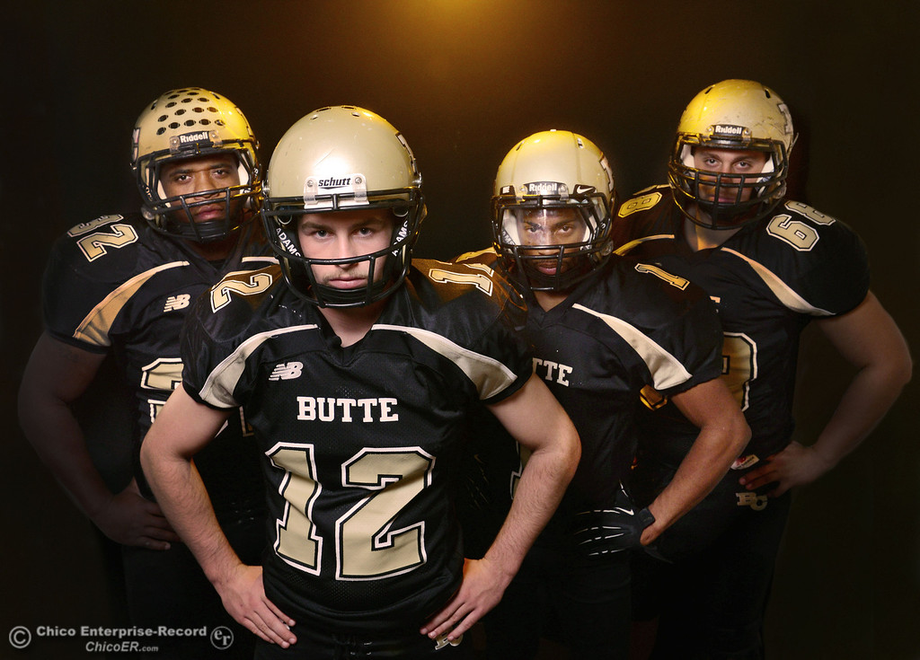 . Butte College Brian Anderson, Thomas Stuart, Wes McCoy, and Eli Thom, who are leading the football team to a winning season, pose for a photo shoot at the Enterprise-Record Wednesday, November 27, 2013 in Chico, Calif.  (Jason Halley/Chico Enterprise-Record)