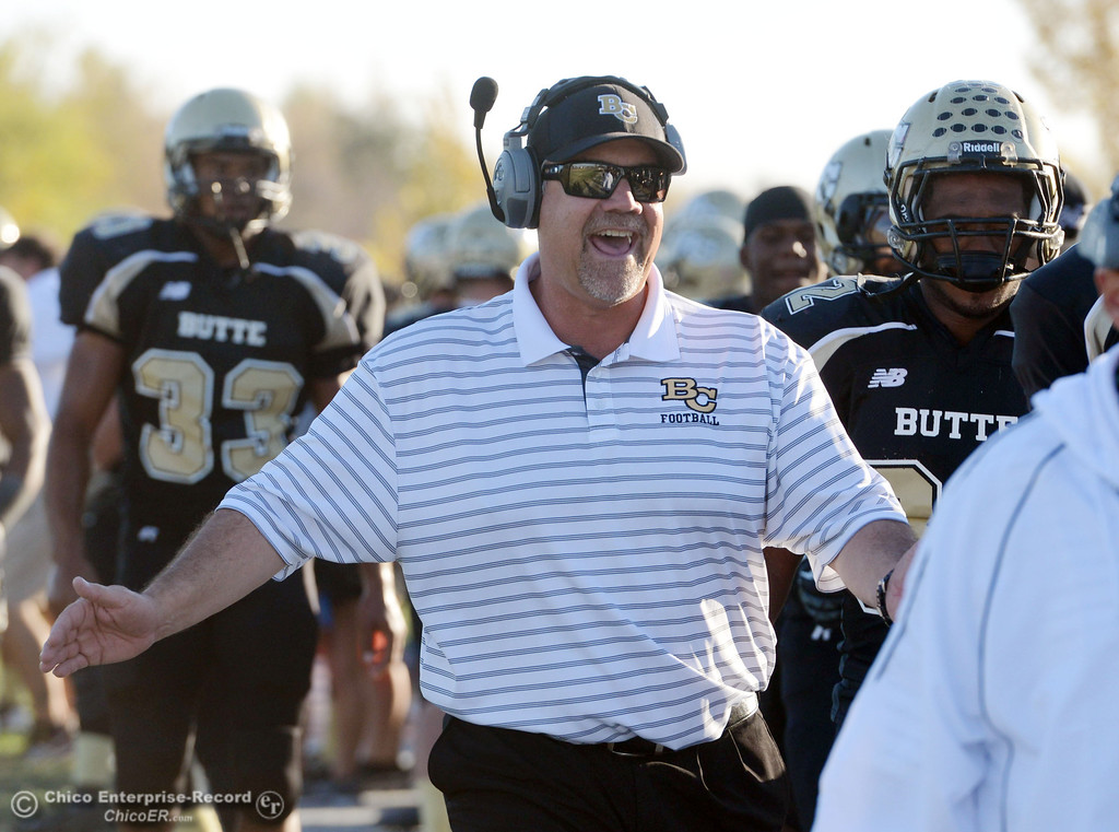 . Butte College defensive line coach Willie Thomas gets excited against City College of San Francisco in the fourth quarter of their football game at Butte\'s Cowan Stadium Saturday, November 16, 2013 in Butte Valley, Calif.  (Jason Halley/Chico Enterprise-Record)