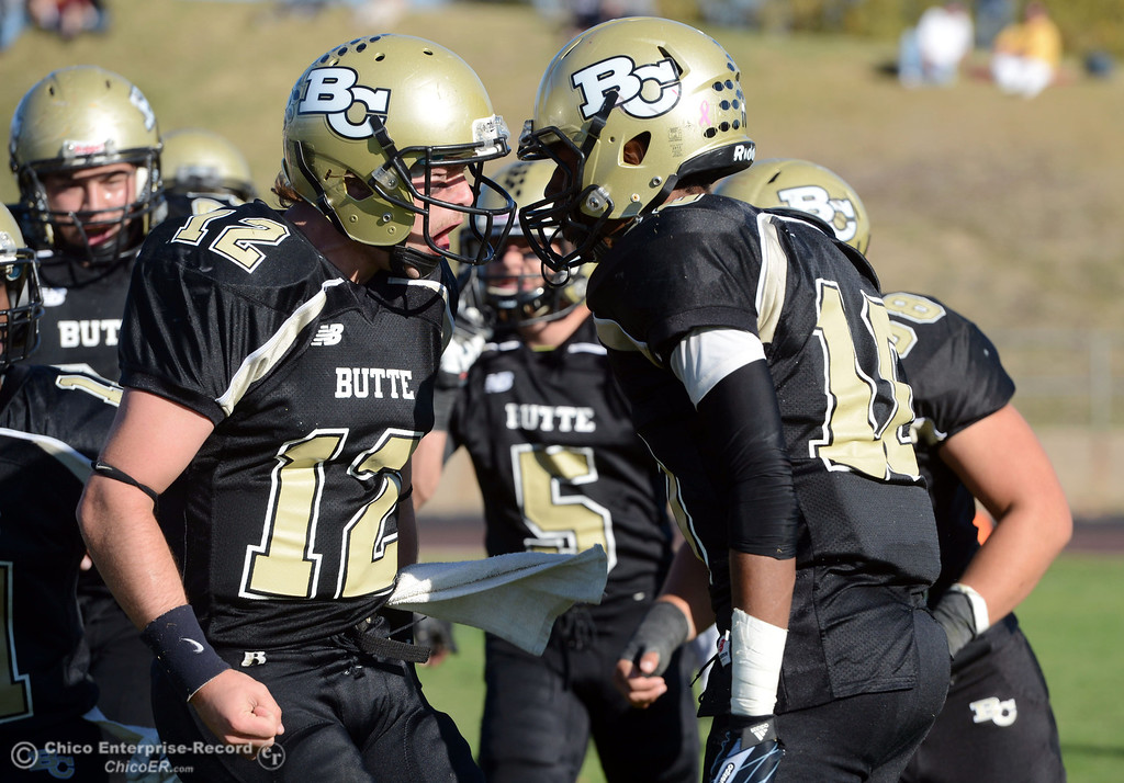 . Butte College\'s #12 Thomas Stuart, (left) congratulates #10 CJ Grice (right) on scoring a touchdown against City College of San Francisco in the second quarter of their football game at Butte\'s Cowan Stadium Saturday, November 16, 2013 in Butte Valley, Calif.  (Jason Halley/Chico Enterprise-Record)