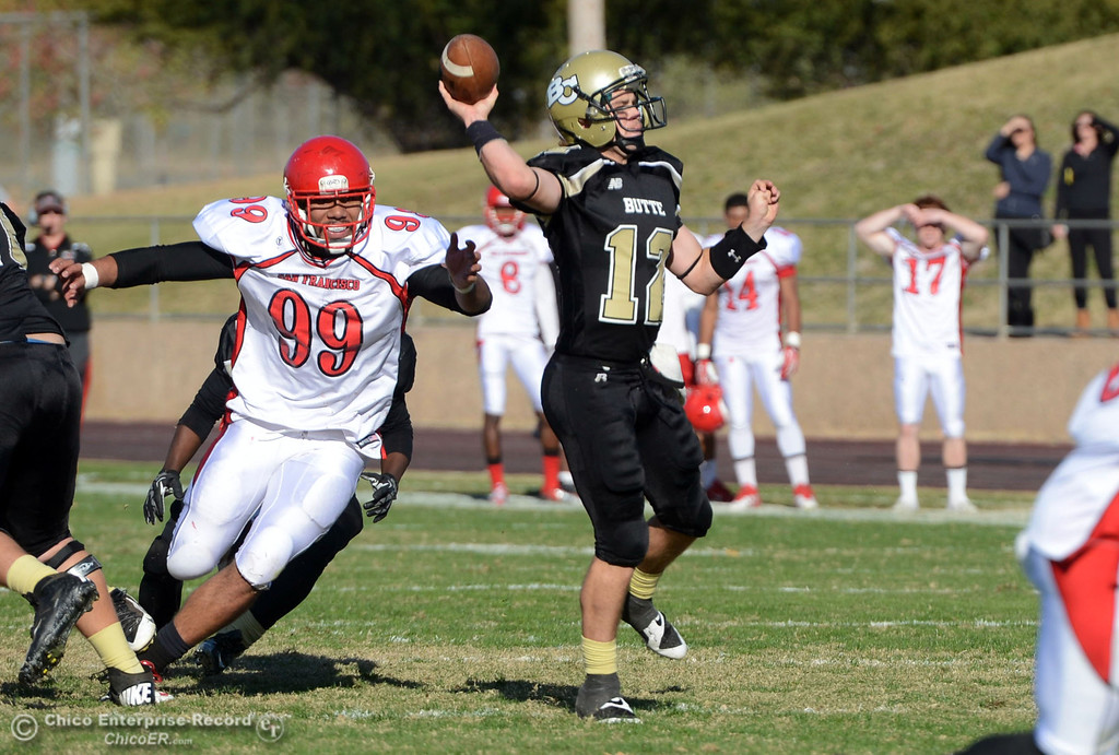 . Butte College\'s #12 Thomas Stuart throws a pass against City College of San Francisco in the second quarter of their football game at Butte\'s Cowan Stadium Saturday, November 16, 2013 in Butte Valley, Calif.  (Jason Halley/Chico Enterprise-Record)