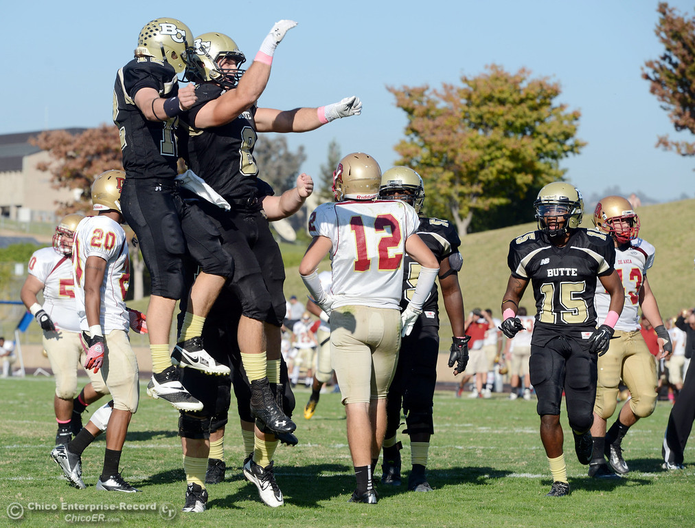 . Butte College\'s #12 Thomas Stuart (left) and #8 Bo Brummel (right) celebrate Brummel\'s touchdown against De Anza College in the third quarter of their football game at Butte\'s Cowan Stadium Saturday, October 26, 2013 in Oroville, Calif.  (Jason Halley/Chico Enterprise-Record)