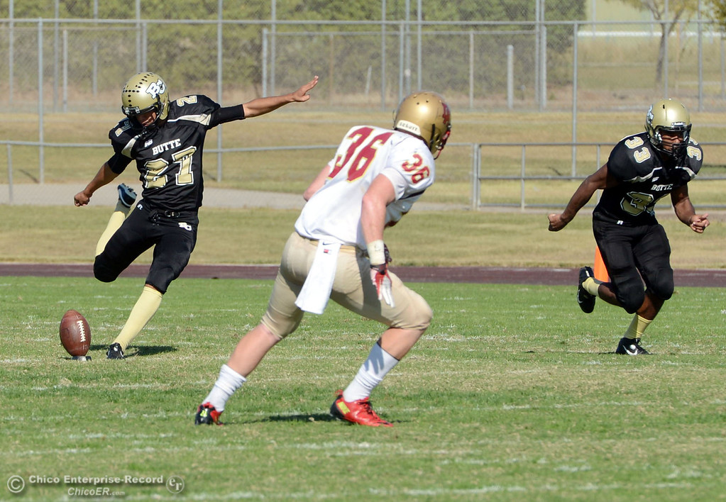 . Butte College\'s #27 Rigoberto Sanchez (left) kicks off against De Anza College in the second quarter of their football game at Butte\'s Cowan Stadium Saturday, October 26, 2013 in Oroville, Calif.  (Jason Halley/Chico Enterprise-Record)