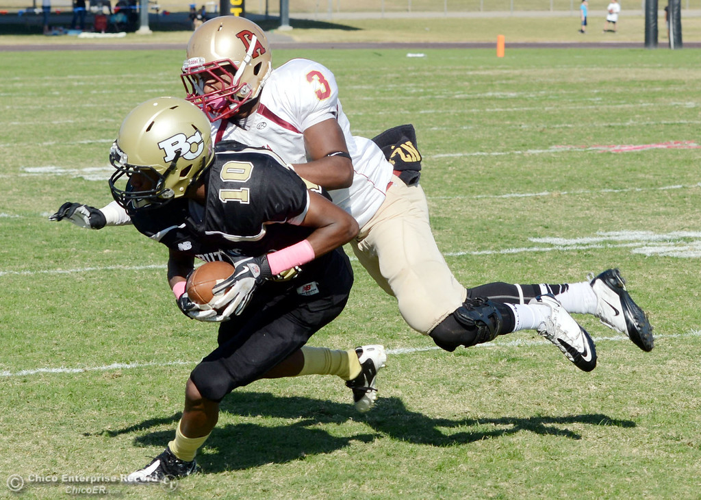 . Butte College\'s #10 CJ Grice (left) is tackled against De Anza College\'s #3 Johnny Beard (right) in the second quarter of their football game at Butte\'s Cowan Stadium Saturday, October 26, 2013 in Oroville, Calif.  (Jason Halley/Chico Enterprise-Record)