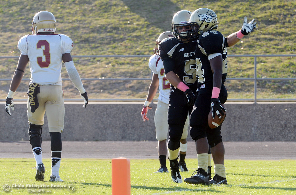 . Butte College\'s #5 David Brannon (left) congratulates #24 Kendall Williams (right) on scoring a touchdown against De Anza College in the fourth quarter of their football game at Butte\'s Cowan Stadium Saturday, October 26, 2013 in Oroville, Calif.  (Jason Halley/Chico Enterprise-Record)