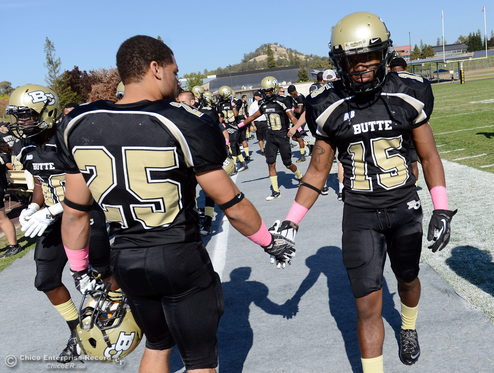 . Butte College\'s #25 De\'Aundray Gooden (left) and #15 Jalen Amis (right) ready against De Anza College in the first quarter of their football game at Butte\'s Cowan Stadium Saturday, October 26, 2013 in Oroville, Calif.  (Jason Halley/Chico Enterprise-Record)