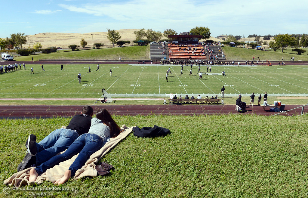. A couple sets up on the grass to view the Butte College against Delta College in the first quarter of their football game at Butte\'s Cowan Stadium Saturday, September 28, 2013, in Oroville, Calif.  (Jason Halley/Chico Enterprise-Record)