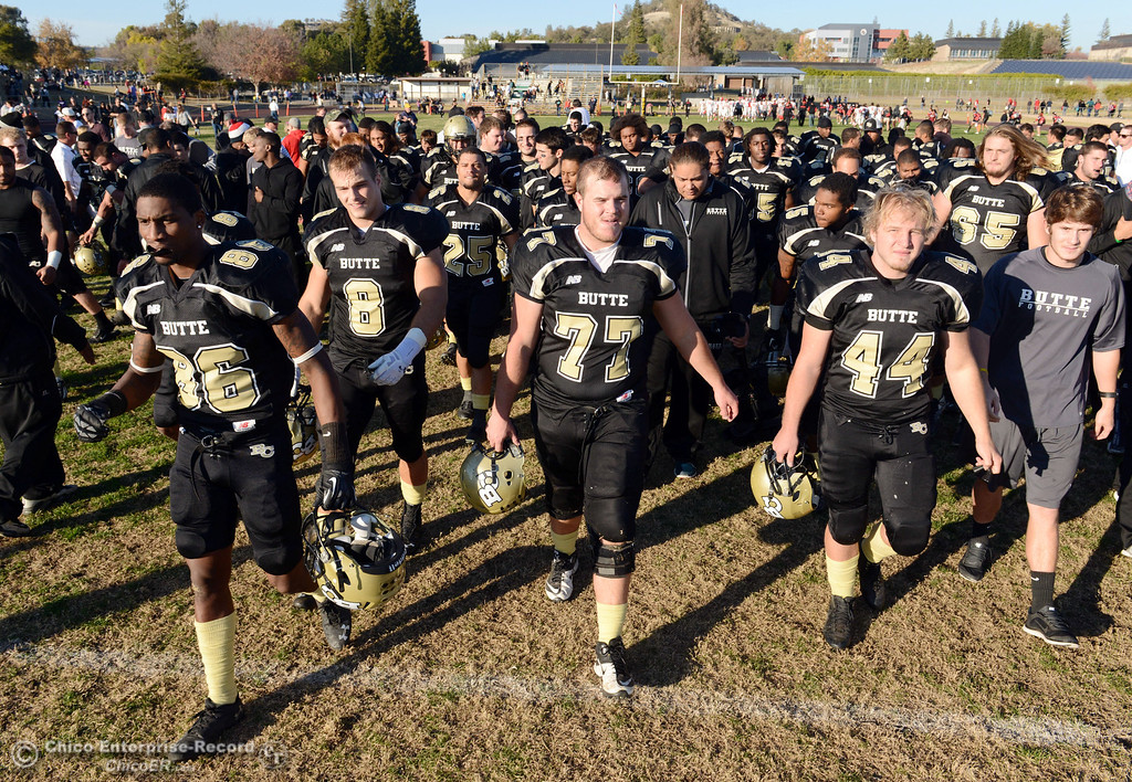 . Butte College\'s #86 Jon Parks, #8 Bo Brummel, #77 Scott Batchelder and #44 Casey Gingerich (left to right) against Fresno City College at the end of their football game at Butte\'s Cowan Stadium Saturday, November 30, 2013 in Butte Valley, Calif.  (Jason Halley/Chico Enterprise-Record)
