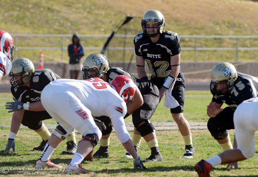 . Butte College\'s #12 Thomas Stuart readies the snap against Fresno City College in the first quarter of their football game at Butte\'s Cowan Stadium Saturday, November 30, 2013 in Butte Valley, Calif.  (Jason Halley/Chico Enterprise-Record)