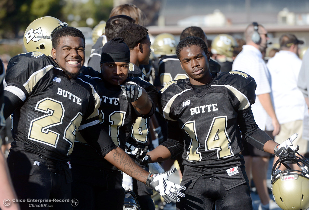 . Butte College\'s #24 Kendall Williams, #21 Marvel Harris, and #14 Robert Frazier (left to right) against Fresno City College in the third quarter of their football game at Butte\'s Cowan Stadium Saturday, November 30, 2013 in Butte Valley, Calif.  (Jason Halley/Chico Enterprise-Record)