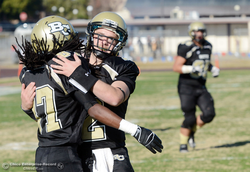 . Butte College\'s #87 Timazray Shepherd (left) and #12 Thomas Stuart (right) celebrate a touchdown by Shepherd against Fresno City College in the second quarter of their football game at Butte\'s Cowan Stadium Saturday, November 30, 2013 in Butte Valley, Calif.  (Jason Halley/Chico Enterprise-Record)