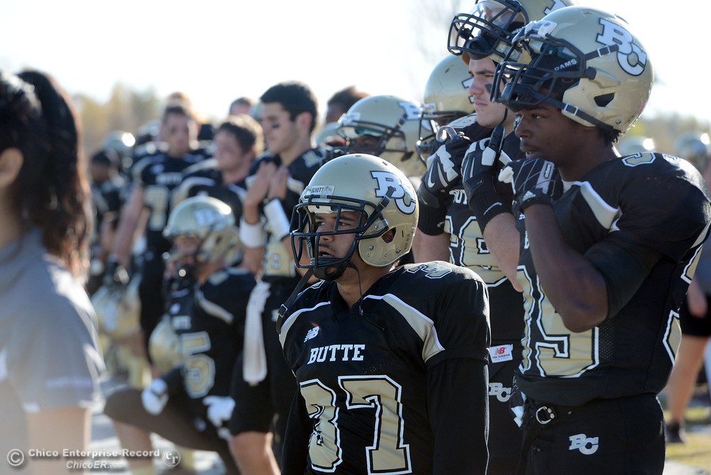 . Butte College\'s #37 Demetre Lopez (left) and #35 Zach Williams (right) look on against Fresno City College in the third quarter of their football game at Butte\'s Cowan Stadium Saturday, November 30, 2013 in Butte Valley, Calif.  (Jason Halley/Chico Enterprise-Record)