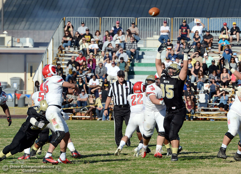 . Butte College\'s #95 Mark Rosenquist (right) throws his hands up on a pass against Fresno City College\'s #15 Marcus Montero (left) in the second quarter of their football game at Butte\'s Cowan Stadium Saturday, November 30, 2013 in Butte Valley, Calif.  (Jason Halley/Chico Enterprise-Record)