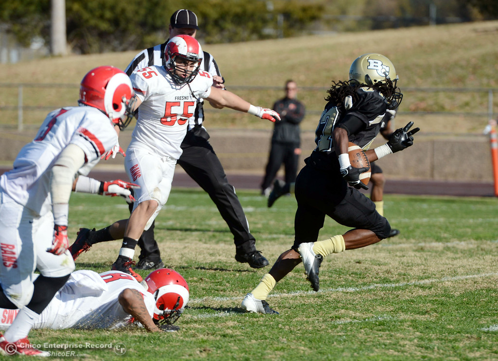 . Butte College\'s #87 Timazray Shepherd (right) rushes for a first down against Fresno City College in the second quarter of their football game at Butte\'s Cowan Stadium Saturday, November 30, 2013 in Butte Valley, Calif.  (Jason Halley/Chico Enterprise-Record)