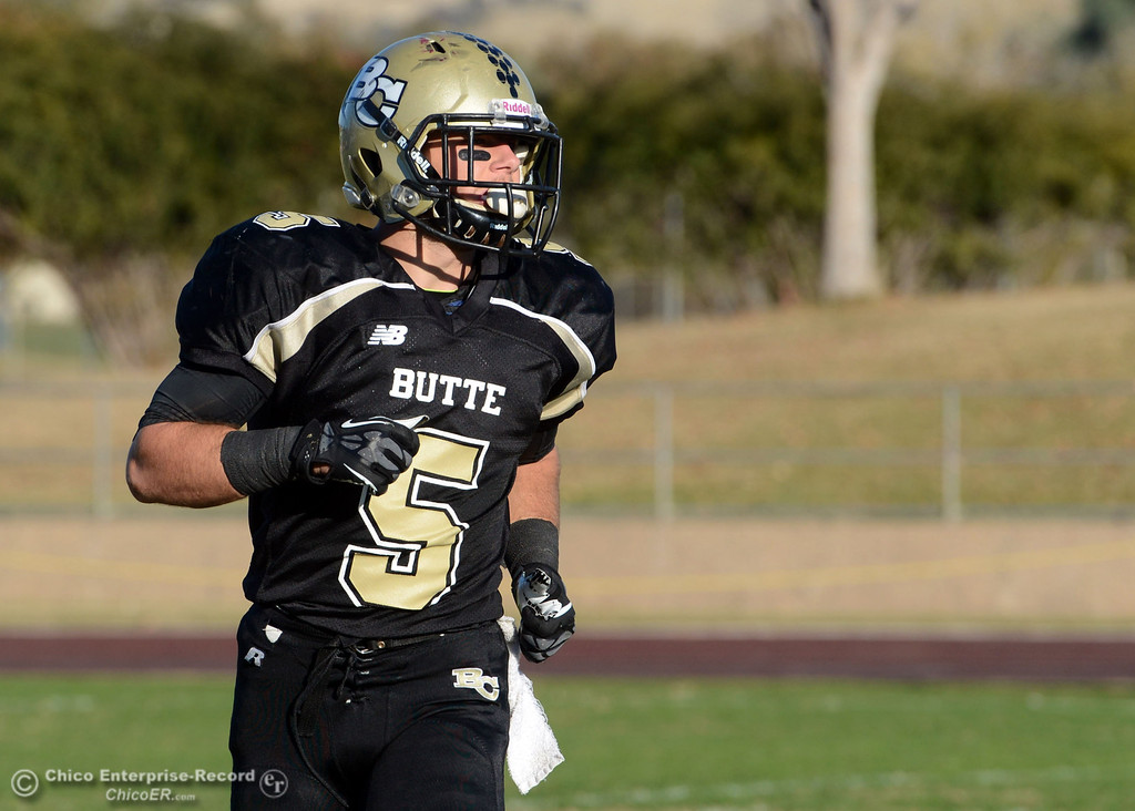 . Butte College\'s #5 David Brannon against Fresno City College in the fourth quarter of their football game at Butte\'s Cowan Stadium Saturday, November 30, 2013 in Butte Valley, Calif.  (Jason Halley/Chico Enterprise-Record)
