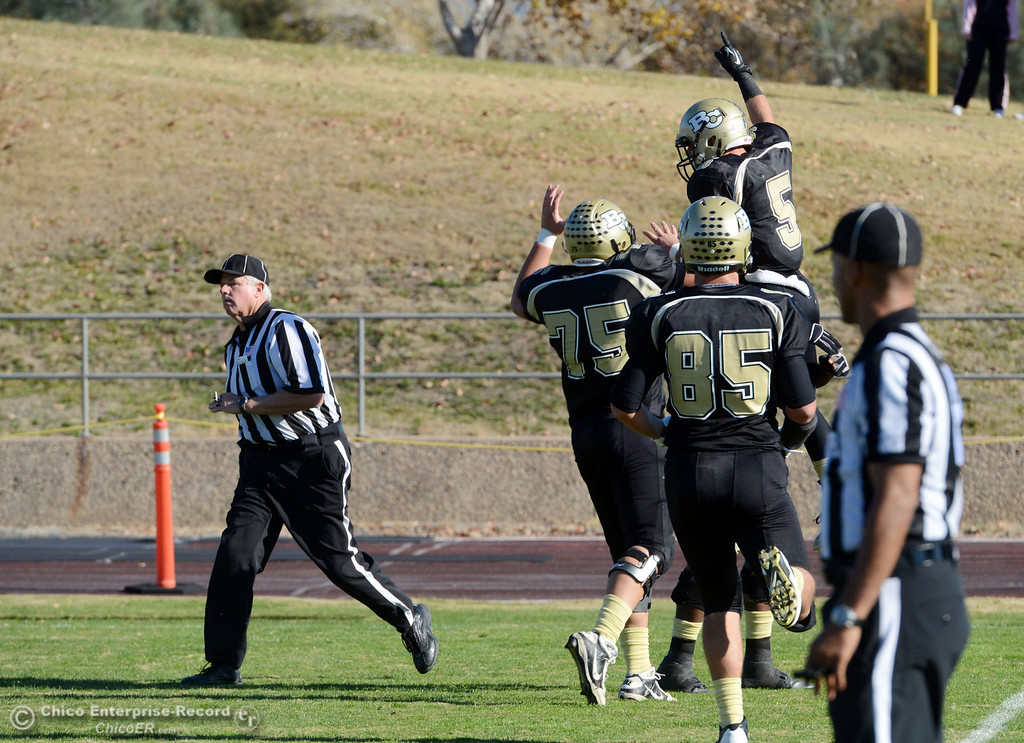 . Butte College\'s #85 Richard Murphy and #75 Jacob Vazquez celebrate a touchdown by #5 David Brannon  against Fresno City College in the second quarter of their football game at Butte\'s Cowan Stadium Saturday, November 30, 2013 in Butte Valley, Calif.  (Jason Halley/Chico Enterprise-Record)