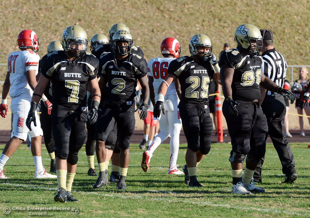 . Butte College\'s #7 Ryan Holland, #2 Deonte Flemings, #25 De\'Aundray Gooden, and #90 Stephen Francois (left to right) against Fresno City College in the fourth quarter of their football game at Butte\'s Cowan Stadium Saturday, November 30, 2013 in Butte Valley, Calif.  (Jason Halley/Chico Enterprise-Record)