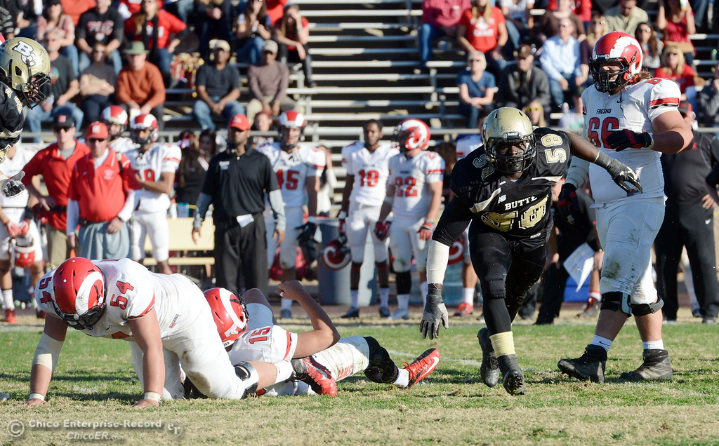 . Butte College\'s #58 Sie Doe Jr. reacts to a stop against Fresno City College in the fourth quarter of their football game at Butte\'s Cowan Stadium Saturday, November 30, 2013 in Butte Valley, Calif.  (Jason Halley/Chico Enterprise-Record)