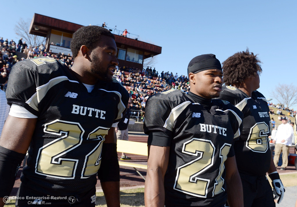 . Butte College\'s #22 Quinta Thomas (left) and #21 Marvel Harris (right) look on against Fresno City College in the second quarter of their football game at Butte\'s Cowan Stadium Saturday, November 30, 2013 in Butte Valley, Calif.  (Jason Halley/Chico Enterprise-Record)