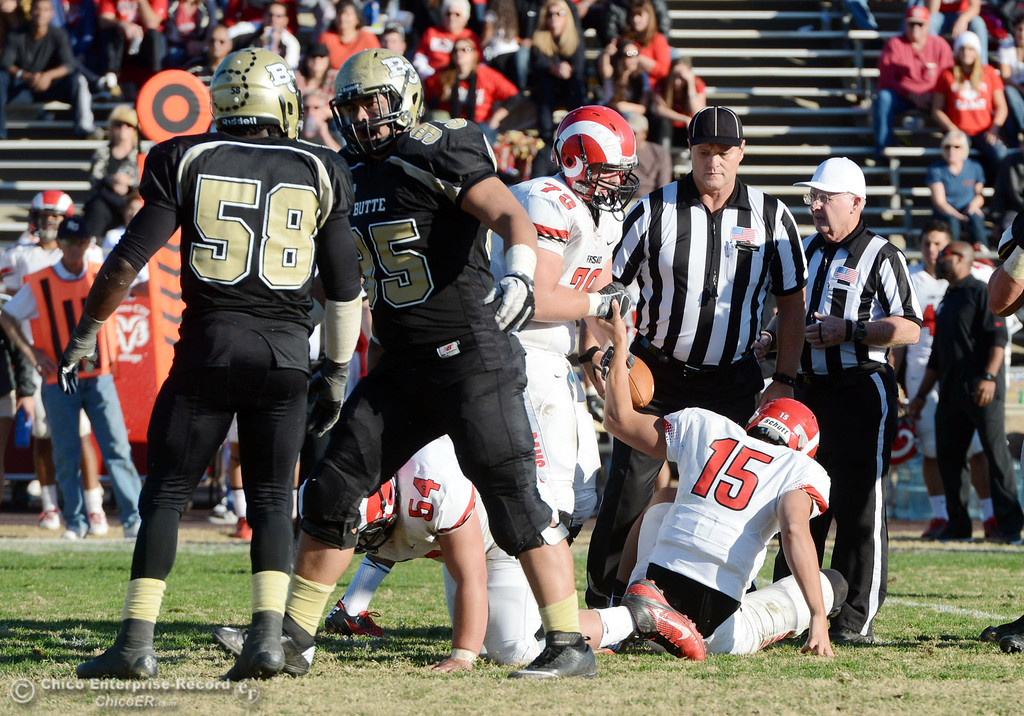 . Butte College\'s #95 Mark Rosenquist (right) congratulates #58 Sie Doe Jr. (left) on a tackle against Fresno City College in the fourth quarter of their football game at Butte\'s Cowan Stadium Saturday, November 30, 2013 in Butte Valley, Calif.  (Jason Halley/Chico Enterprise-Record)