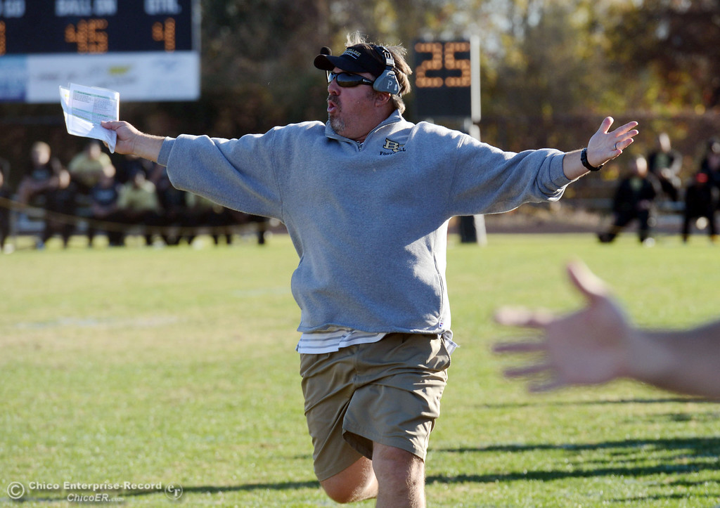 . Butte College coach Jeff Jordan runs down the sideline to argue a flag that was thrown on a play against Fresno City College in the fourth quarter of their football game at Butte\'s Cowan Stadium Saturday, November 30, 2013 in Butte Valley, Calif. The flag was called off by officials. (Jason Halley/Chico Enterprise-Record)
