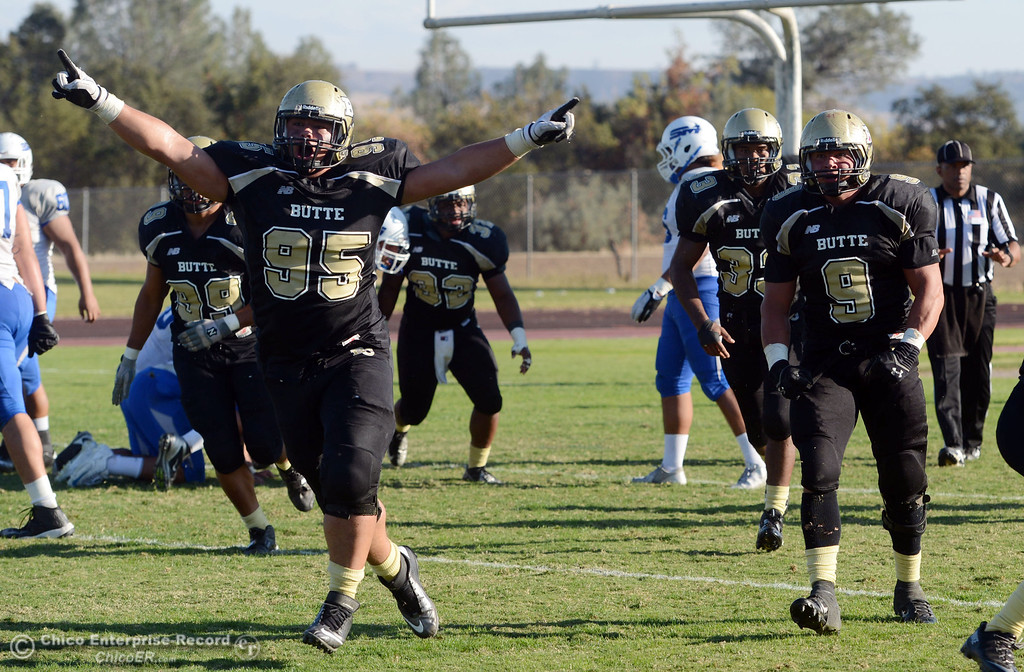 . Butte College\'s #95 Mark Rosenquist (left) celebrates the win against College of San Mateo in the fourth quarter of their football game at Butte\'s Cowan Stadium Saturday, November 2, 2013 in Oroville, Calif.  (Jason Halley/Chico Enterprise-Record)