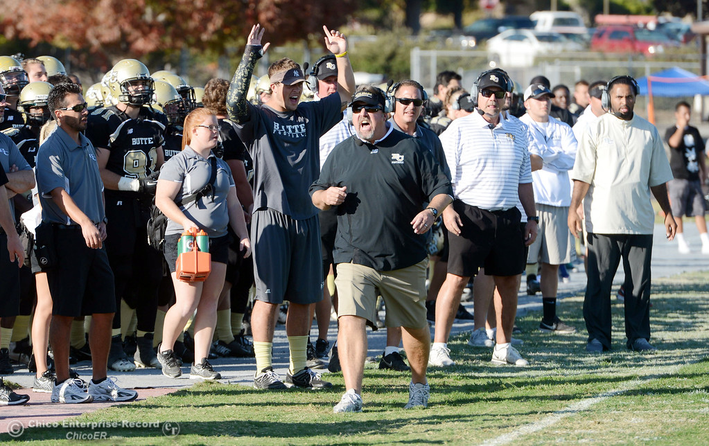 . Butte College coach Jeff Jordan (center) calls out to the ref against College of San Mateo in the fourth quarter of their football game at Butte\'s Cowan Stadium Saturday, November 2, 2013 in Oroville, Calif.  (Jason Halley/Chico Enterprise-Record)