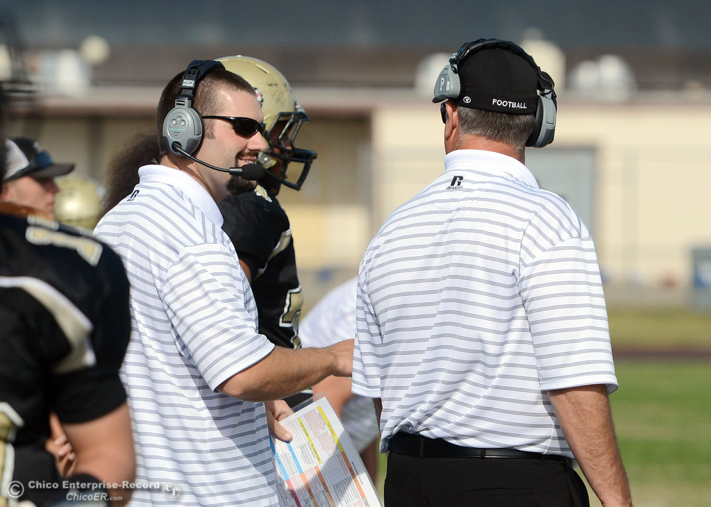 . Butte College coach Rob Snelling (left) and Willie Thomas (right) against San Mateo College in the first quarter of their football game at Butte\'s Cowan Stadium Saturday, November 2, 2013 in Oroville, Calif.  (Jason Halley/Chico Enterprise-Record)