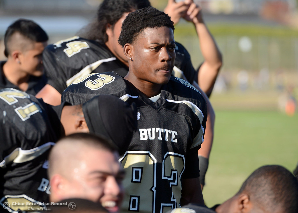 . Butte College\'s #83 Terez Cowan listens to the coach at the end of their football game against College of San Mateo at Butte\'s Cowan Stadium Saturday, November 2, 2013 in Oroville, Calif.  (Jason Halley/Chico Enterprise-Record)