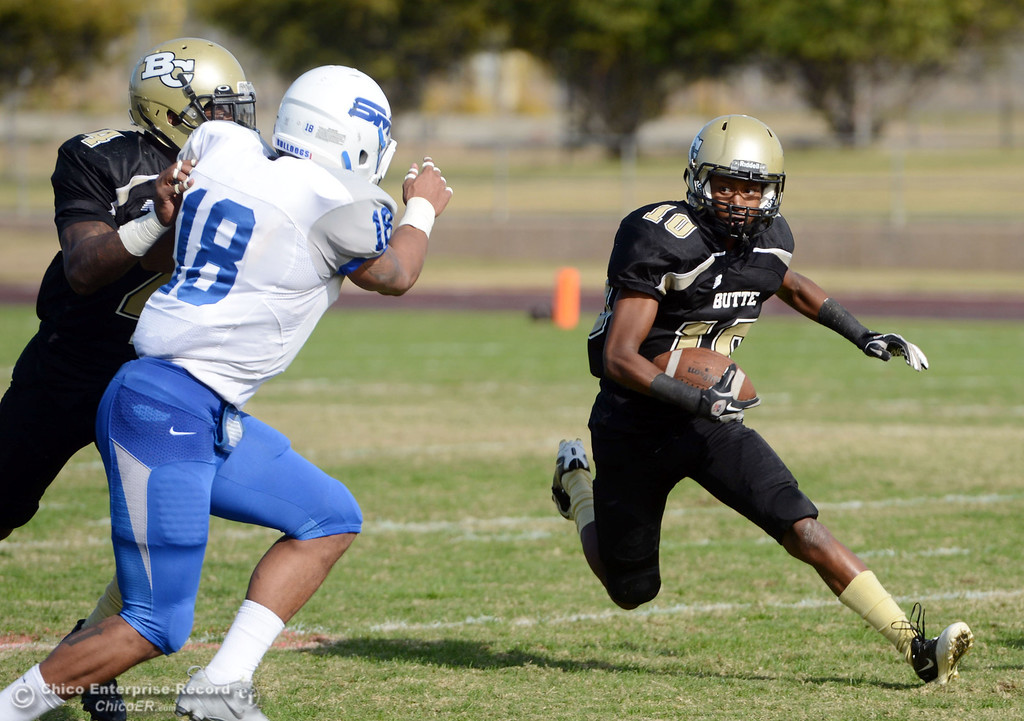 . Butte College\'s #10 CJ Grice rushes against College of San Mateo in the second quarter of their football game at Butte\'s Cowan Stadium Saturday, November 2, 2013 in Oroville, Calif.  (Jason Halley/Chico Enterprise-Record)