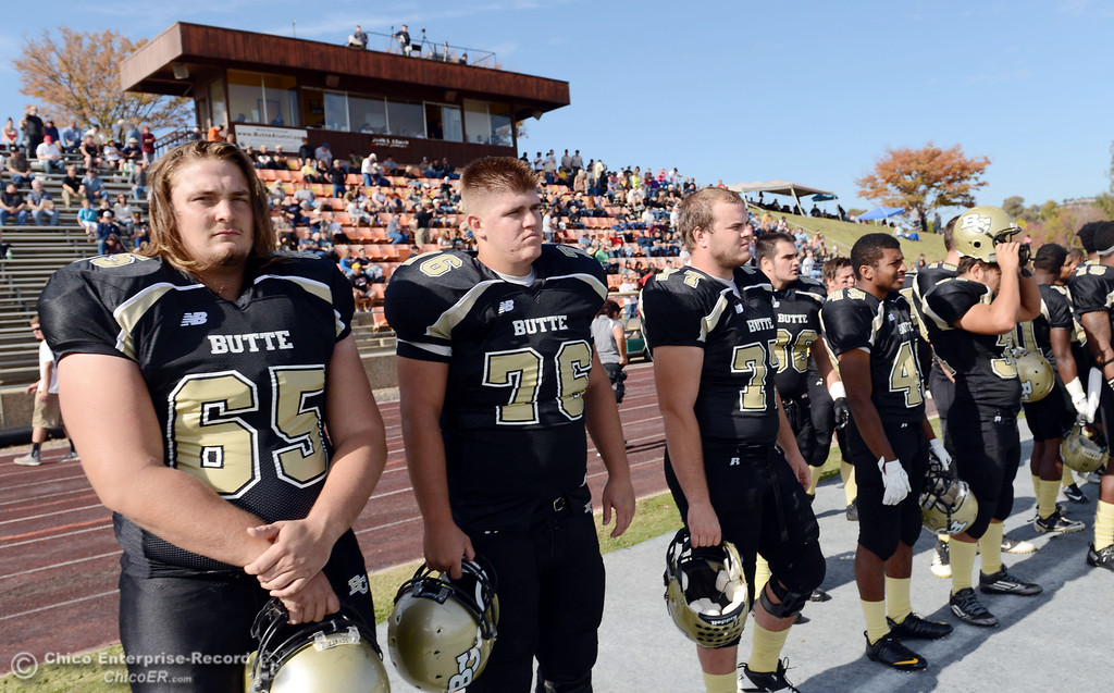 . Butte College\'s #65 Tyler Anglin (left) #76 Kevin Camy, and #77 SCott Batchelder (right) on the sidelines against San Mateo College in the first quarter of their football game at Butte\'s Cowan Stadium Saturday, November 2, 2013 in Oroville, Calif.  (Jason Halley/Chico Enterprise-Record)