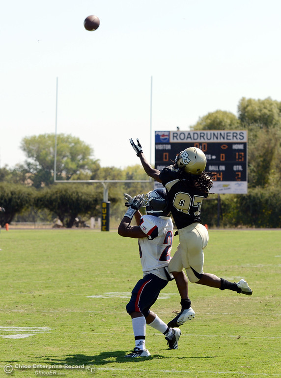 . Butte College\'s #87 Timazray Shepherd (right) catches the ball in the end zone for a touchdown against College of the Siskiyous\' #25 Malachi Knox (left) in the second quarter of their football game at Butte\'s Cowan Stadium on Saturday, September 14, 2013, in Oroville, Calif. (Jason Halley/Chico Enterprise-Record)