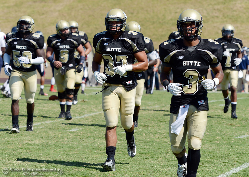 . Butte College\'s #37 Demetre Lopez (center) and #3 London Muse (right) come off the field against College of the Siskiyous in the second quarter of their football game at Butte\'s Cowan Stadium on Saturday, September 14, 2013, in Oroville, Calif. (Jason Halley/Chico Enterprise-Record)