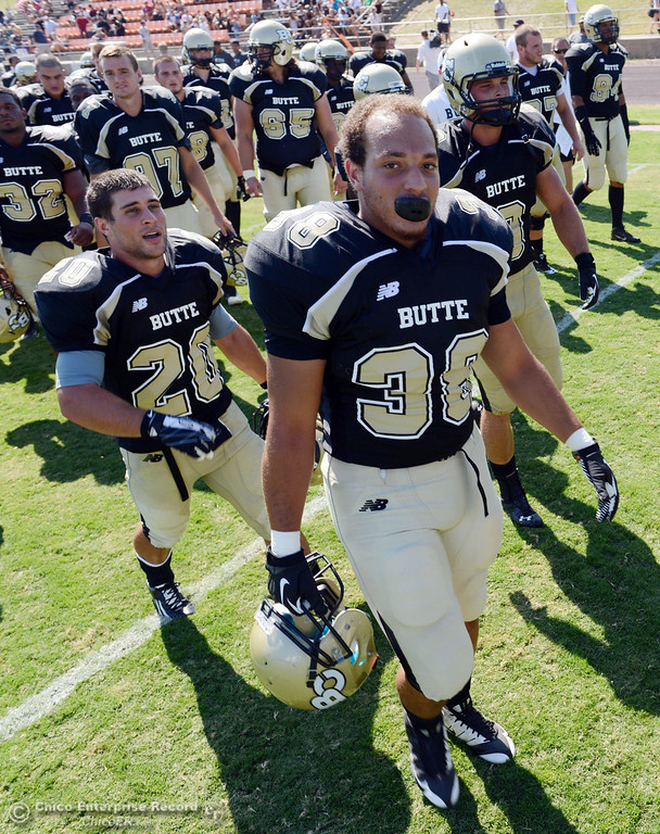 . Butte College\'s #20 Armand Bokitch and #38 Marcus McDonald (left to right) and others walk off the field against College of the Siskiyous at the end of the half of their football game at Butte\'s Cowan Stadium on Saturday, September 14, 2013, in Oroville, Calif. (Jason Halley/Chico Enterprise-Record)