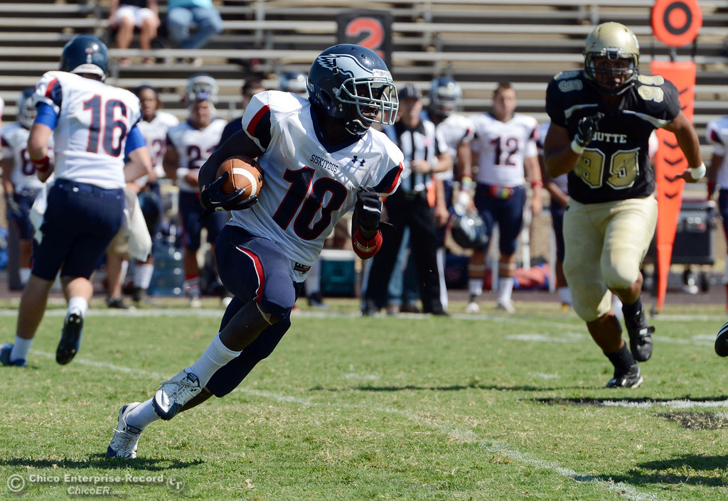 . College of the Siskiyous\' #10 Kirt Terry-Springs rushes against Butte College in the second quarter of their football game at Butte\'s Cowan Stadium on Saturday, September 14, 2013, in Oroville, Calif. (Jason Halley/Chico Enterprise-Record)