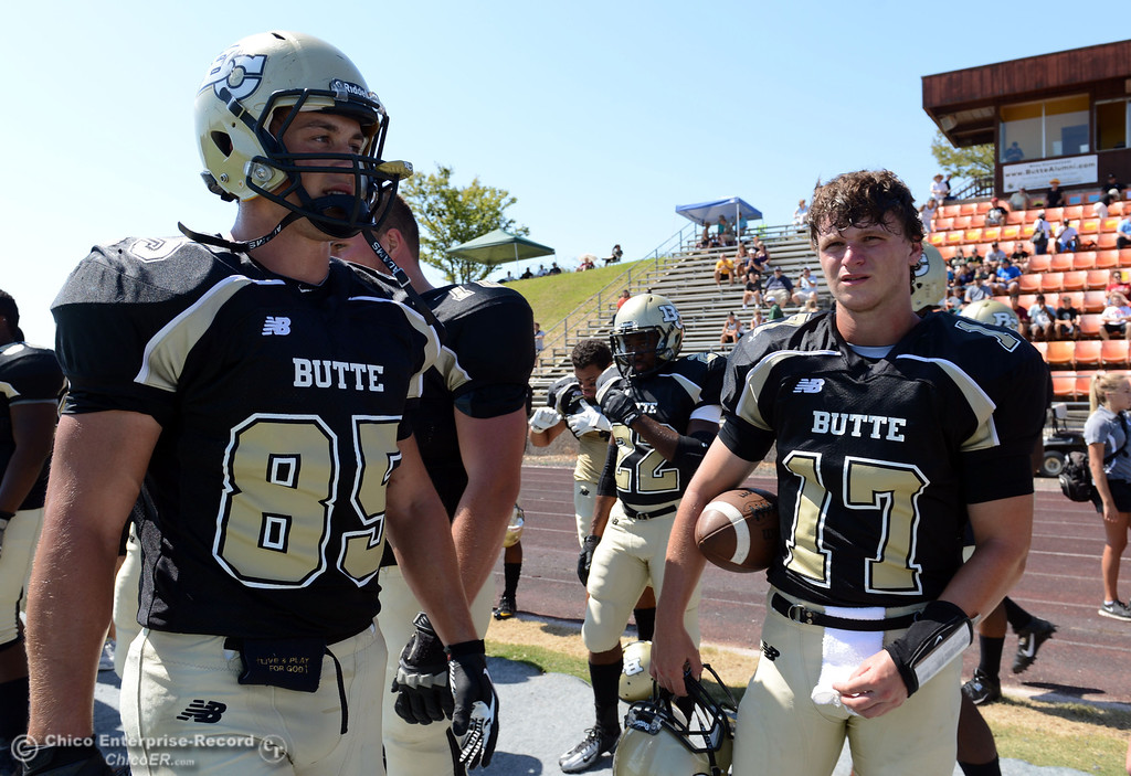 . Butte College\'s #85 Richard Murphy (left) and #17 Peter Wysong (right) look on against College of the Siskiyous before the first quarter of their football game at Butte\'s Cowan Stadium on Saturday, September 14, 2013, in Oroville, Calif. (Jason Halley/Chico Enterprise-Record)