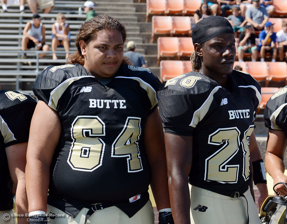 . Butte College\'s #64 Jesse Savusa (left) and #28 Christopher Lowery (right) against College of the Siskiyous before the first quarter of their football game at Butte\'s Cowan Stadium on Saturday, September 14, 2013, in Oroville, Calif. (Jason Halley/Chico Enterprise-Record)