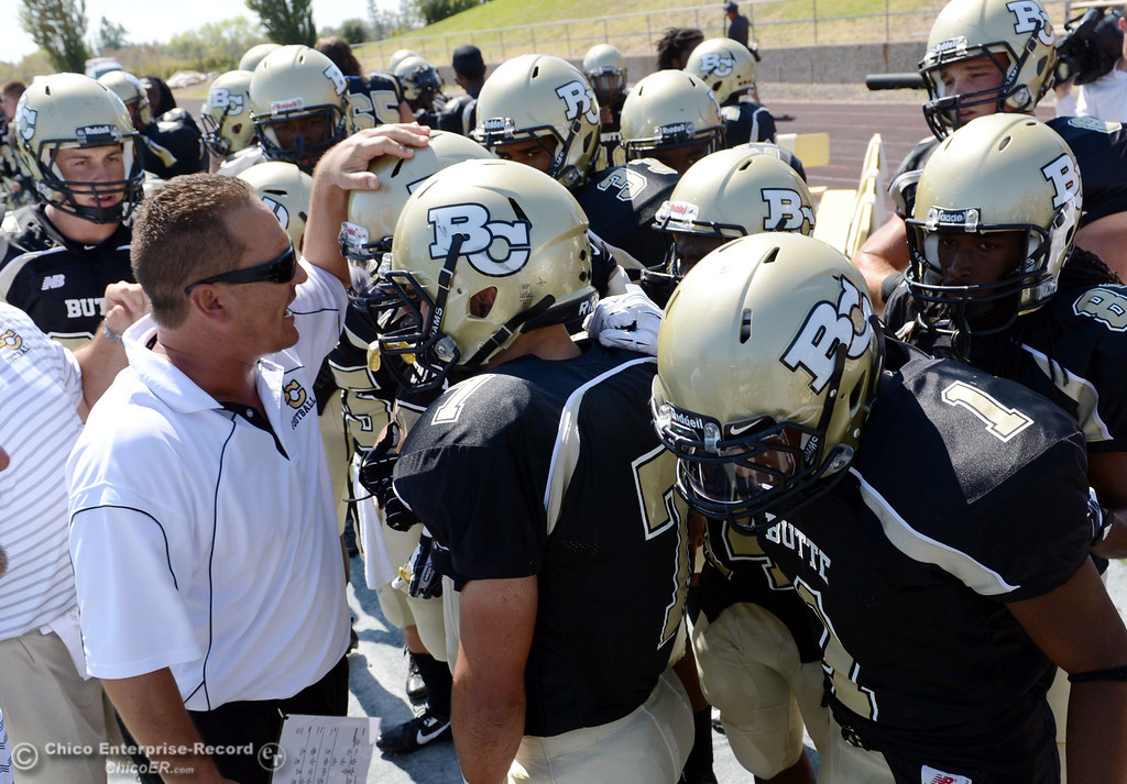 . Butte College coach Tim Garcia (left) preps the team against College of the Siskiyous before the first quarter of their football game at Butte\'s Cowan Stadium on Saturday, September 14, 2013, in Oroville, Calif. (Jason Halley/Chico Enterprise-Record)