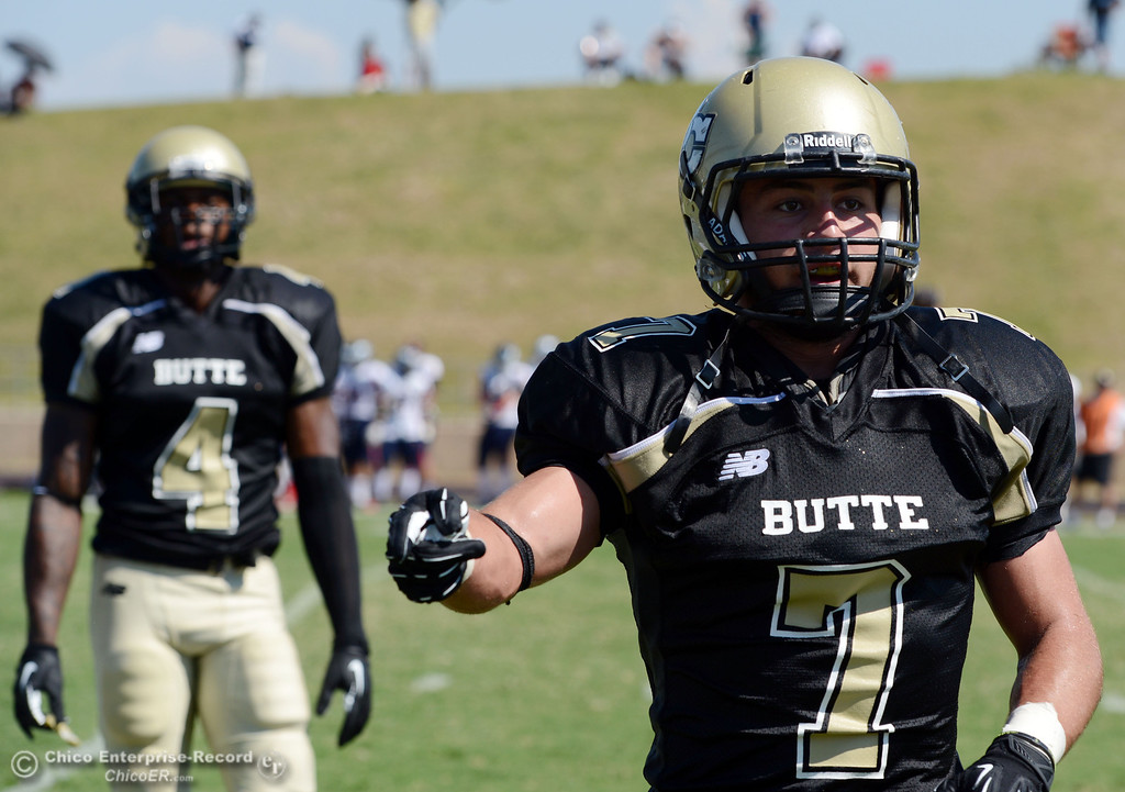 . Butte College\'s #7 Ryan Holland comes off the field against College of the Siskiyous in the second quarter of their football game at Butte\'s Cowan Stadium on Saturday, September 14, 2013, in Oroville, Calif. (Jason Halley/Chico Enterprise-Record)